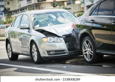car crash accident on street. damaged automobiles