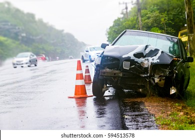 car crash accident on street, damaged automobiles after collision in rain-ny day