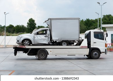 car crash accident on car Towing Truck . And moving to the truck for repair .