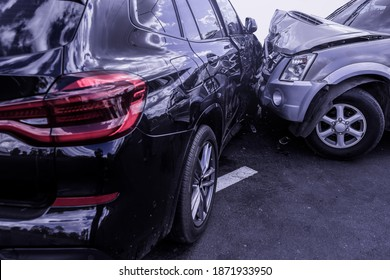 Car crash dangerous accident on the road. Car crashing beside another one on the road.