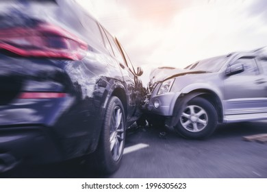 Car crash dangerous accident on the road. SUV car crashing beside another one on the road with speed zoom blur.