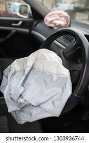 Car Crash; Deployed drivers airbag.