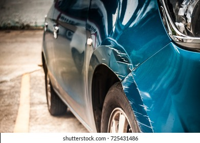 The car and the crash point above the wheel