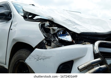 Car Crash, White Car Get Damaged by Accident on the Road.