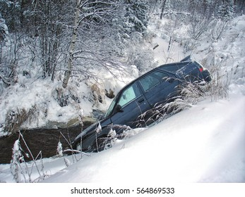 Car crash winter. Flew off the road into the Creek. Winter road in Russia.