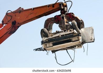 car crushing at crushing yard