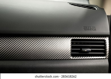 Car dashboard. Air conditioning system and airbag panel. Interior detail.