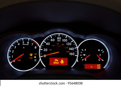 Car Dashboard. Close up image of illuminated car dashboard.