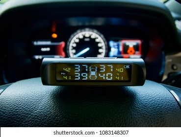 Car dashboard close up with tire pressure monitor, car tyre pressure, TPMS