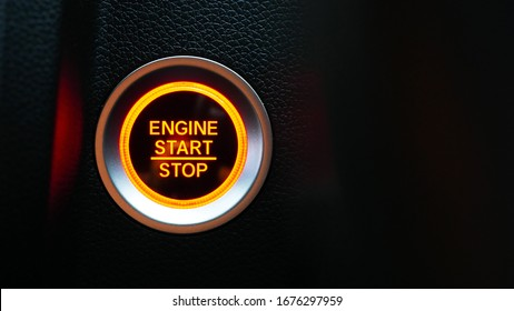 Car dashboard with focus on red engine start stop button, car interior details. button engine start and engine stop, Car engine push start stop button ignition remote starter.