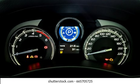 Car dashboard have a Speed meter, Tachometer, Temperature meter, Fuel indicator, Trip mile meter, Seat-belt warning light, Turn signal indicator, Door open warning light, Battery warning light