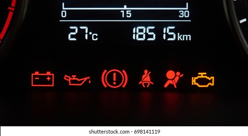 Car dashboard icons close-up. Error vehicle signs