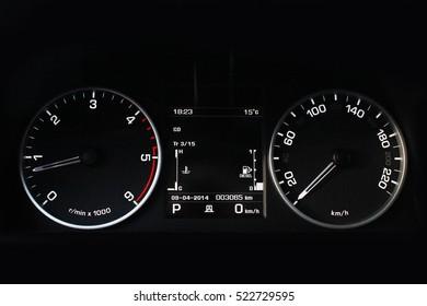 Car dashboard, illuminated panel, speed display. Car. Black