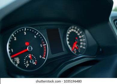 Car dashboard with lighting and engine starting