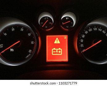 Car dashboard with low battery alert
