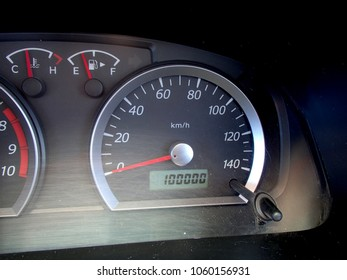 Car dashboard with odometer showing 100000 km mileage