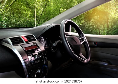 Car dashboard over nature background