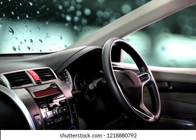 car dashboard over wet background