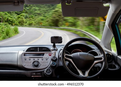 Car dashboard speeds while on the road curve. car driving fast