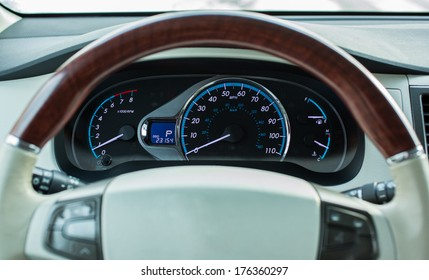 Car dashboard with steering wheel