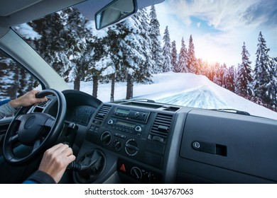 Car dashboard and steering wheel inside of car. winter landscape. Travel concepte