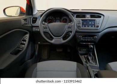 Car dashboard and steering wheel, modern car interior dashboard