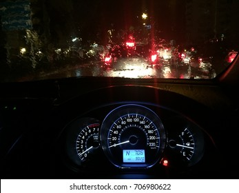 Car dashboard and wet windshield from a heavy rain in a heavy traffic in Chiang Mai, Thailand. selective focus.