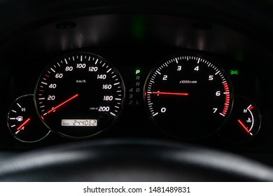 Car dashboard with white  backlight: Odometer, speedometer, tachometer, fuel level, water temperature and more