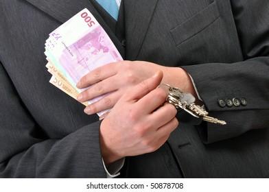 Car dealer. Businessman with euro banknotes and car keys.