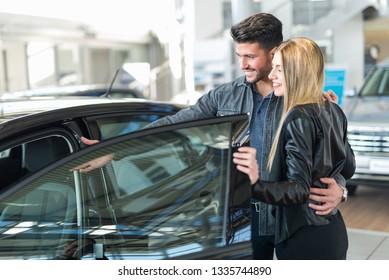 Car dealer new car concept, couple choosing a car