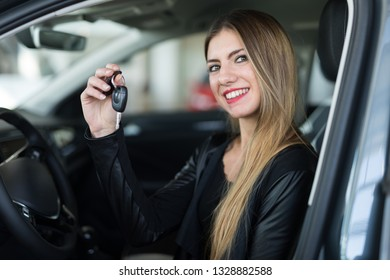 Car dealer new car concept, woman showing car keys