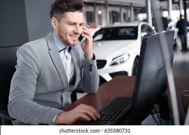 Car dealer on the phone talking with client