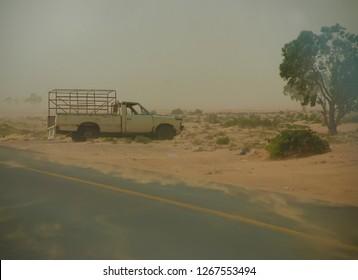 A car was destroyed by the Army of Muammar Gaddafi. Benghazi-Tripoli highway. The Arab Spring in Libya begins. April 7, 2011, Benghazi, Libya.