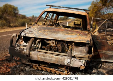 Car destroyed by fire on the road