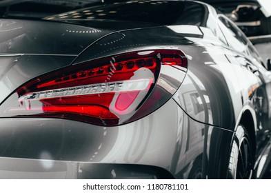 Car detailing : Glass coating Closeup modern glossy shineCloseup modern luxury gray Back lights headlight and head lamp sport car . Dealership office showroom sale epic wallpaper. Tuning design rental - Shutterstock ID 1180781101