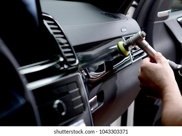 Car detailing - Man holds a polisher in the hand and polishes the car.