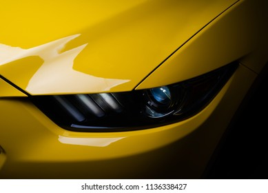 Car detailing series: Clean headlights of yellow sports car