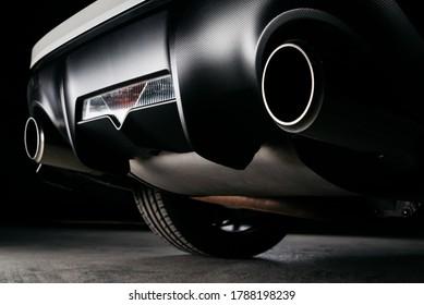 Car detailing series: Closeup of black car dual exhaust pipe