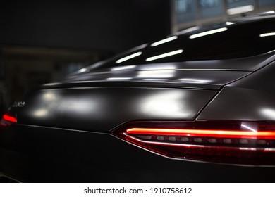 Car detailing series : Closeup black car lamp