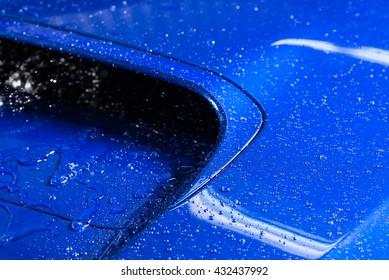 Car detailing series : Droplets on blue car bonnet