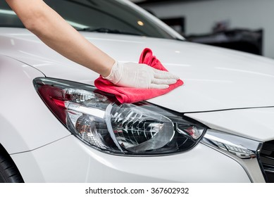 Car detailing series : Worker cleaning  white car