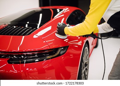 Car detailing - Worker with orbital polisher in auto repair shop. Selective focus. - Shutterstock ID 1722178303