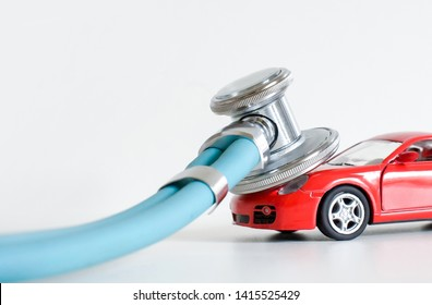 Car diagnostics, stethoscope and car on white background, concept of car inspection, repair and maintenance
