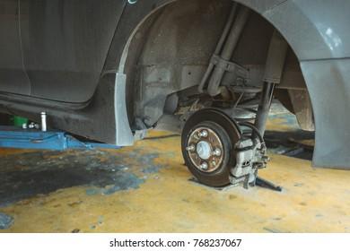 Car disc brake without wheels in garage