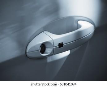 Car door handle closeup (toned blue).