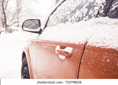 Car door handle winter frost snow flakes ice crystals