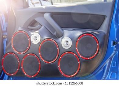 car door with lots speakers, upgrade car audio system, premium audio sound for car