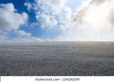 Car drift asphalt square under the blue sky