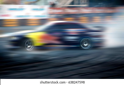 Car drifting,Race car racing on speed track with motion blur.