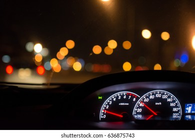 The car drive time in the night city, bokeh background